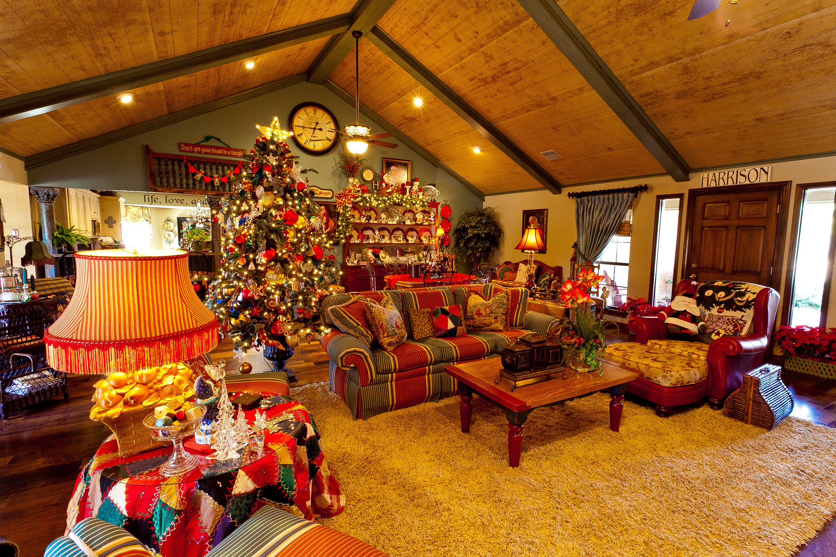 Show me a country french home dressed for christmas show Holiday decorated homes