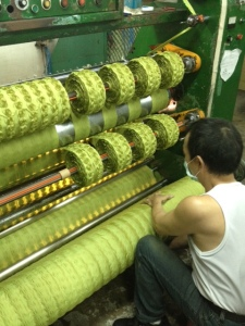 fabric goes through several steps before it is ribbon. Wire is being added to the edge of this fabric!