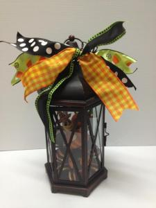 Finished  lantern ready to light up your Halloween! By choosing your Holiday, fall could be pumpkins and leaves and Christmas, ornaments and balls then add the perfect coordinating ribbon and you have a Lantern for all seasons!