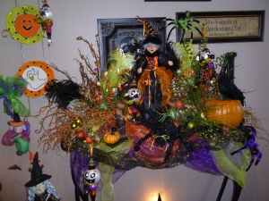 Halloween is front and center as you enter the house. She has chosen her entry table to display fun Halloween with pops of purple and lime green along with the traditional orange and black!