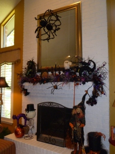 The mantel is a great focal point! The large spider is creeping down the mirror! a witch,ghost and pumpkin complete the scene!