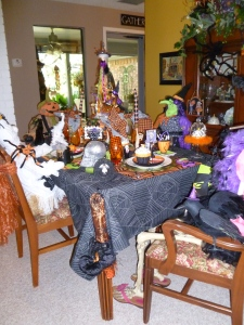 Beverly's dining table is set for a party...a ghostly party, complete with characters! Even her grandaughters life size doll is in costume.