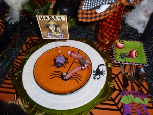 Creepy crawly ghoulish dishes are not for the quimish! Fun colorful placemats, tablecloth,placecards, glass cupcake ornaments all are part of her vast collection.