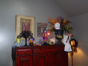 Gina's colorful electic house lends itself well to whimsical Halloween decorations featured here on her buffet!