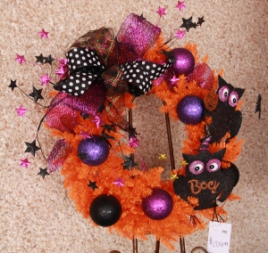 Black and white and hot pink and purple pop against an orange wreath! this wreath is a simple version, easy for a beginner!