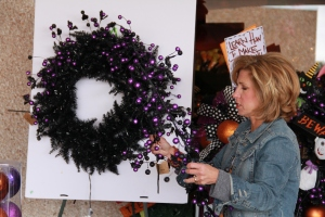 Always shape out floral garlands and picks before attaching to wreath base. Wired stems and garlands are prefered!