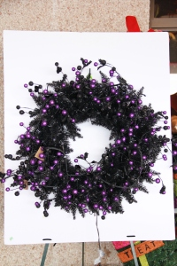 "Fun Halloween garland is added to black wreath base, this 30"" wreath required 2!"