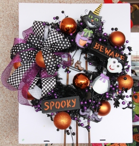 Finished wreath! The two characters plus the bow, form a triangle, fill in with signs and add balls!
