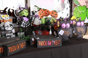 Metal characters lend whimsey to Halloween decor, because they are light weigth they are easy to attach with wire. Signs always tell a story!
