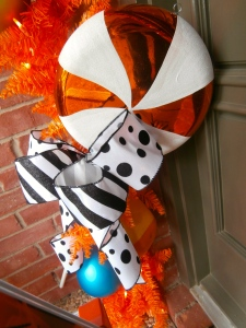 To update your Halloween, add Black and white, polka dots and stripes with wired ribbon. the wider the ribbon the less it takes to make an impact. loops and tails make for a fun bow treatment. Quality ribbon will last several years.