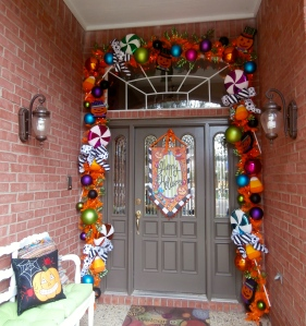 The Lisa Frost Halloween banner was the inspiration for this fun and colorful halloween doorway!