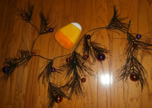 A lightweight glitter pine garland (2 each) are a great base to intwine in the arms of the Chandelier, the orange and purple balls add a pop of color!