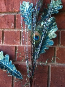These 2 floral stems are wired together to add into the peacock inspired doorway.