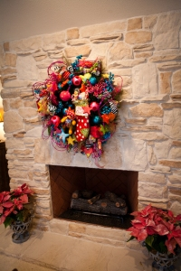 Fun, colorful wreath adds whimsy to this fireplace!