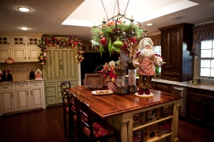 Mark Robert's Santa stands guard over the baking station on this kitchen island!
