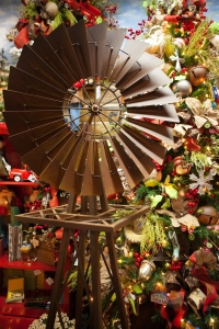 An iconic image from the West Texas plains, a rusty Windmill displayed alongside this Wild Wild West Texas Christmas Tree.