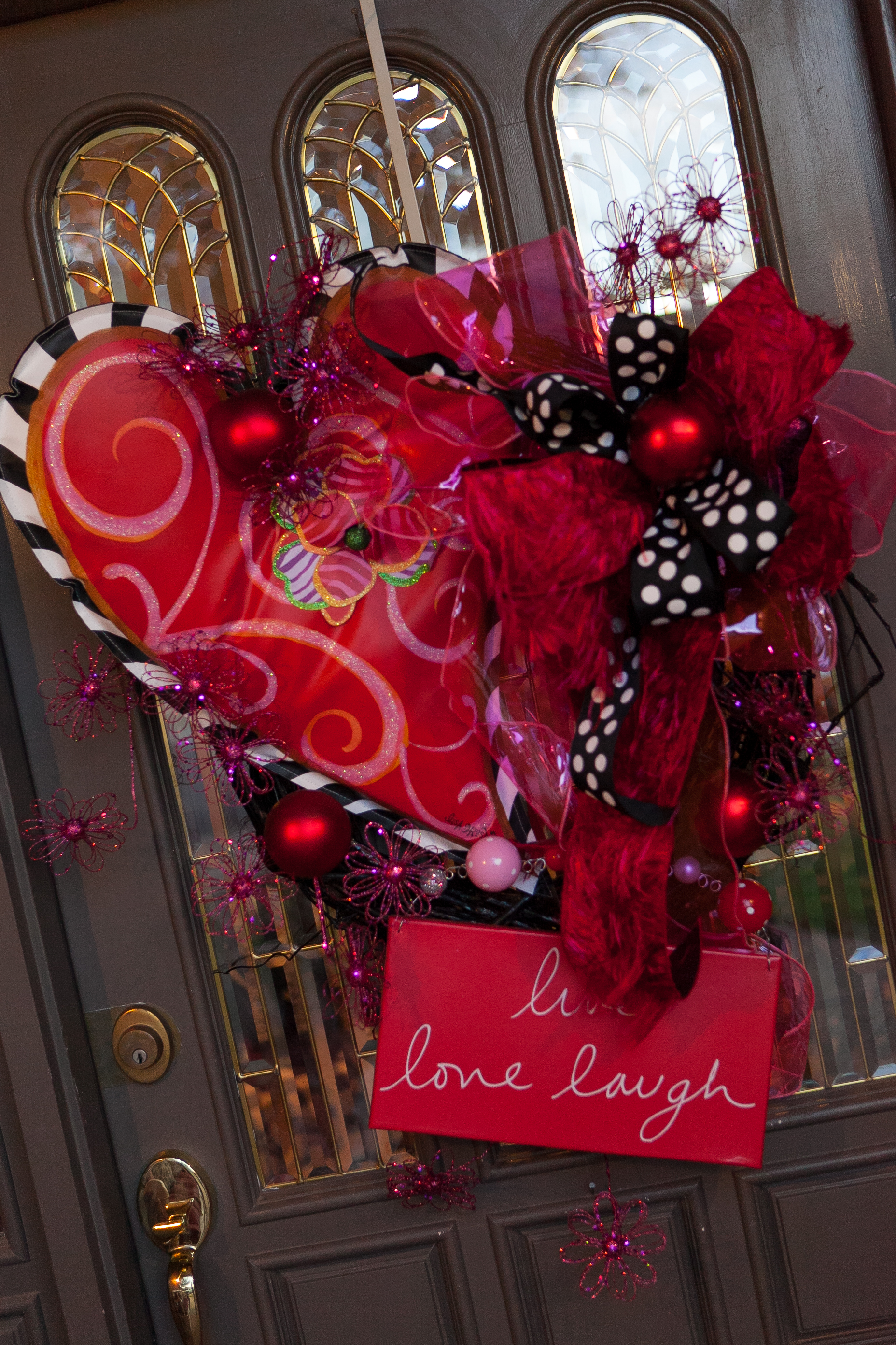 My door is the 1st impression of the theme of the party! Love the & Lisa Frost Heart banner | Show Me Decorating