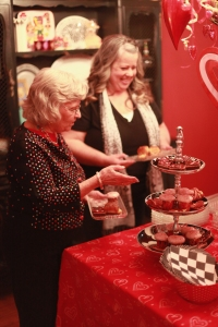 Betty & Tammy help themselves to assorted treats! Black and white serving pieces coordinate with party theme!