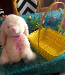 Fluffy Easter bunny and yellow basket