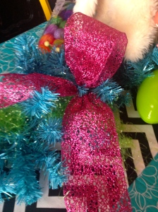 Attach a single loop bow on each end of the garland and the 2 loop bow by the Bunny and basket!