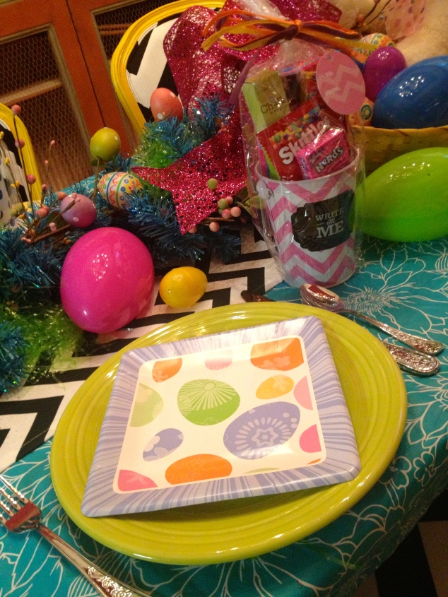 Mixing everyday dinnerware (Fiesta) and seasonal paper goods makes for a fun place setting