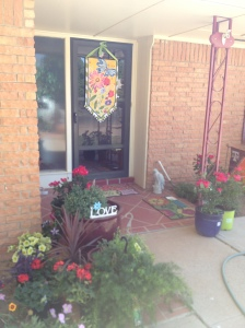 The front porch loaded with all the plants, pots and new doormat, let the work begin!