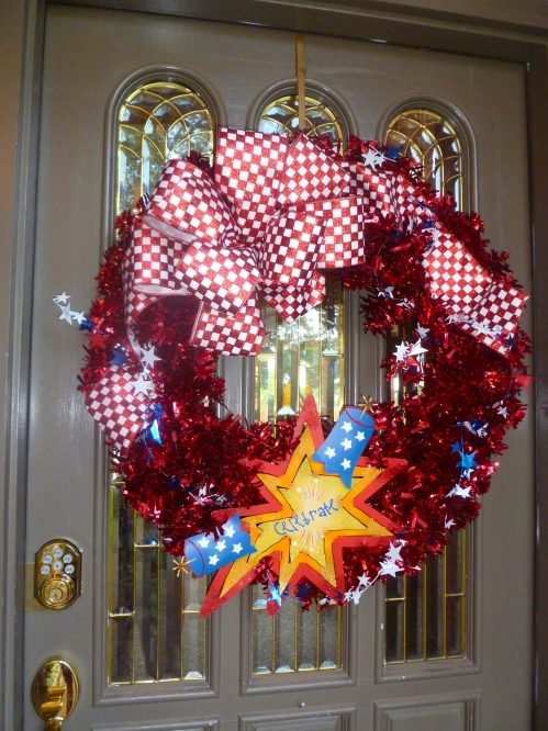 Red Tinsel Wreath with Popping firecracker and big Red Check bow!