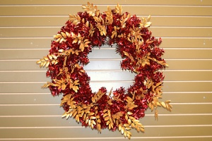 Add in gold glitter garland and attach by twisting branches of wreath over main stem like a twist tie.