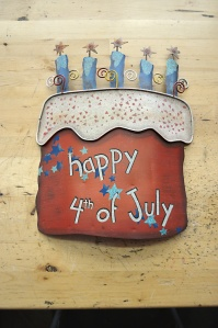 Focal point,Happy 4th of July Cake from the Round Top Collection. Perfect to brighten up your front porch or as an addition to a wreath.