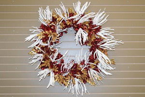 Wire in White Glitter Grass stems by twisting wreath branches over stems like a twist tie