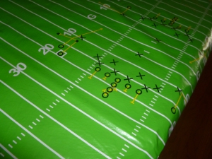Vinyl Football Field material was found at Hancock's fabrics, 3 yds and used on the main food table.