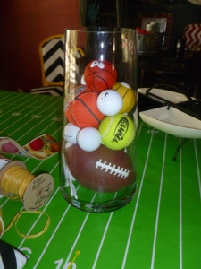 Small Nerf football fits nicely at the bottom, golf balls, tennis balls and and toy balls are colorful and carry out our sports theme.