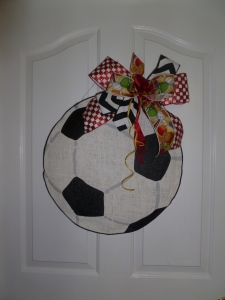 Soccer ball is topped off with a cute bow!