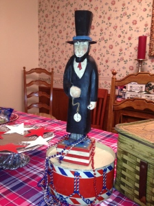 Abe Lincoln stands tall on antique metal lunch box, beaded necklaces (used to mark the bunko) add some whimsy!