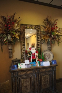 Decorate your entrance console with a Santa surrounded by Christmas Cards and dress up everyday florals with Christmas Sprays and Ribbon to match the Christmas Tree! West Texas Abstract