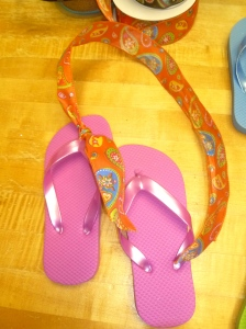 1 Pink flip flop tied with orange paisley wired ribbon.