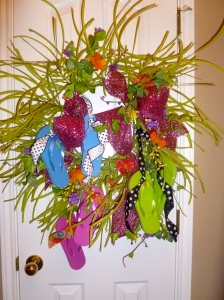 3 pairs of flip flops tied on to wreath base