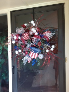 Guest are welcomed at the front door with a fun firecracker popping 4th of July wreath, a hint to the celebration inside!