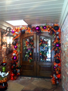 Bright orange Halloween garland with pops of purple, welcomes ghost and goblins to stop by for a treat!