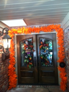 The bright orange pops against this entranceway.