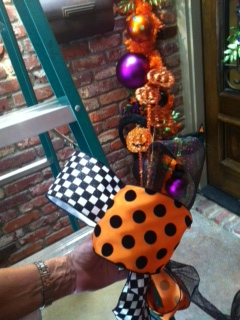Ribbon loops and tails are attached to fun picks and sprays and wired onto the garland base.