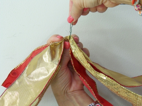 Florist wire is used to hold the ribbon tie together, and add to the wreath.