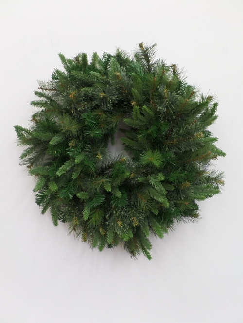 """Faux mix pine wreath is fluffed and shaped to come """"alive"""" before adding in floral stems"""
