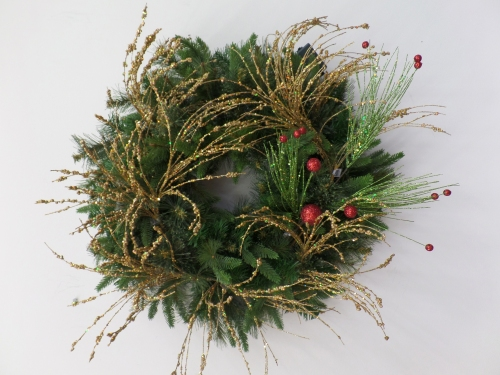 Next layer is a green glitter spray with red glitter balls, shape and add to wreath.