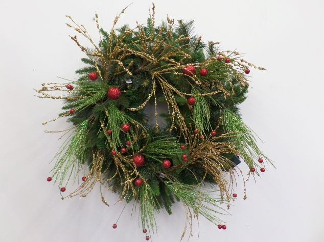 3 green glitter sprays with red glitter balls were layered and wired onto the Faux green pine wreath base.