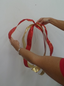 Another Show Me Decorating key ingredient is used, Ribbon! Cuts lengths of each ribbon (approx.1yd) and place a wire in about the middle leaving one side a little longer.