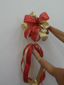Tie a coordinating bow. get the Show Me Decorating app, to learn to tie a bow.
