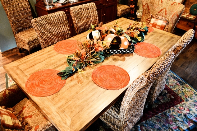 Metal Pumpkins gather in a Tray to create a Dining table Autumn centerpiece.