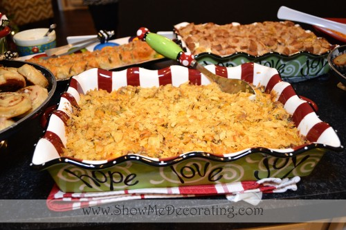 Brunch Egg Casserole serves up beautifully in a Christmas casserole dish.