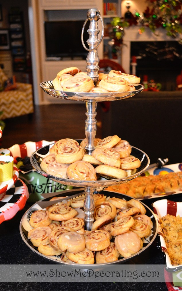 Maple-bacon breakfast rolls served on a metal tiered tray, Miss Cayce's Christmas Store Mary Engelbreit and Mark Robert's Christmas brunch